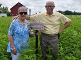 Bob and Ellie Beck stand in Prairie & Wildflower Garden named in their honor.
