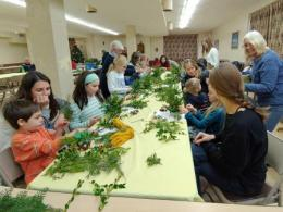 Preschools use found items to create holiday arrangement.