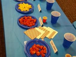 Tomatoes are prepared for tasting and judging.